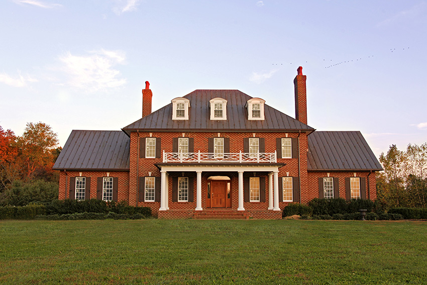 Brick mansion with pillars and grand entrance