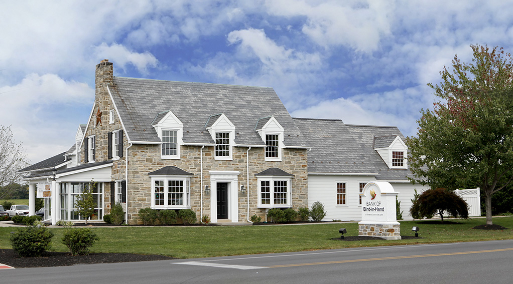 Hybrid stone and timber frame building