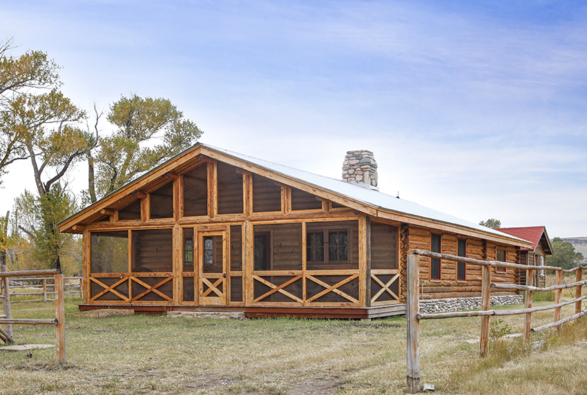Timber frame cabin with prominent screened in porch