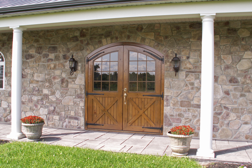Home with arched entrance of eastern white pine