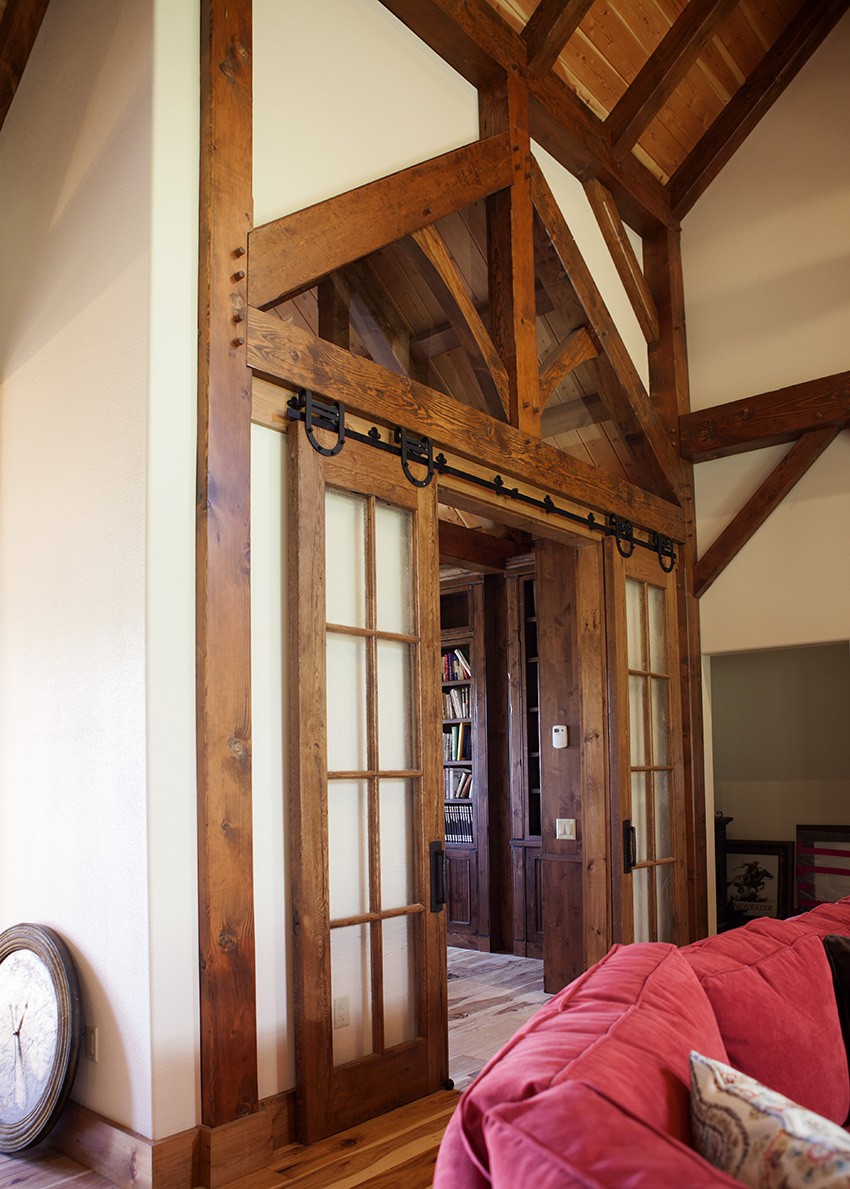 Sliding door with timber frame decoration above the door