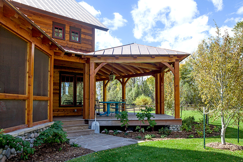 Porch with timber frame beams and roof