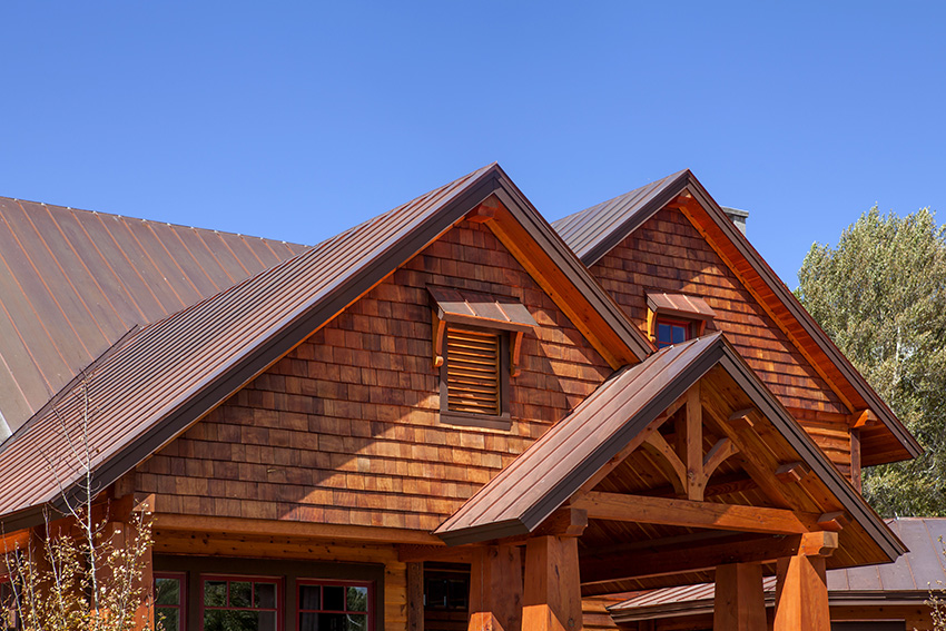 Copper standing seam roof on a timber frame home
