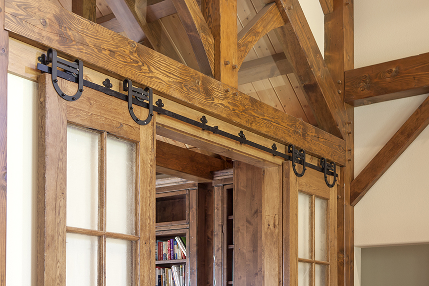 Timber frame beam detail over a sliding door