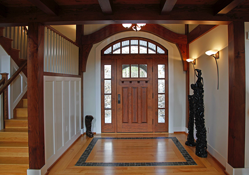 Solid wood door with sidelights in foyer area