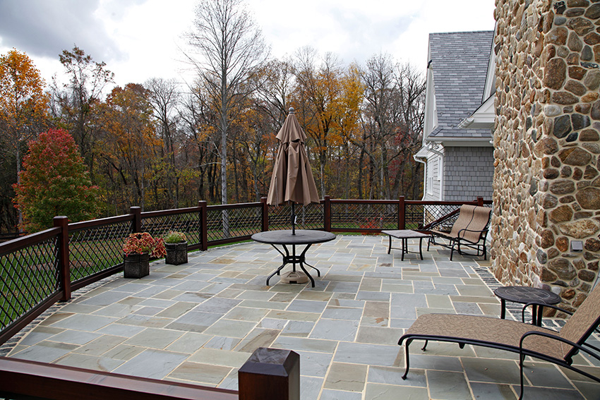 Slate and stone patio with fence