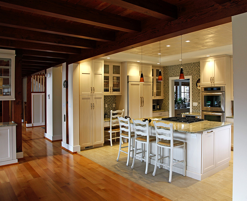 Open concept kitchen with timber frame beams