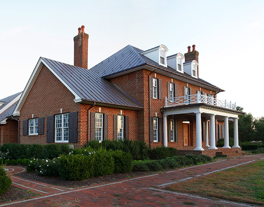 Side view of a brick house and new entryway
