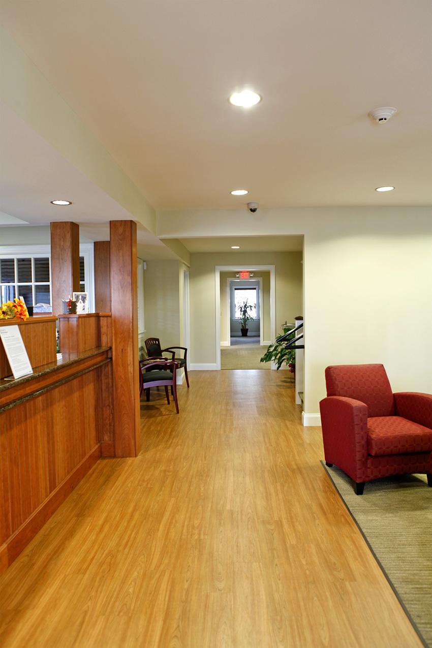 Hallway with wood floors and beams