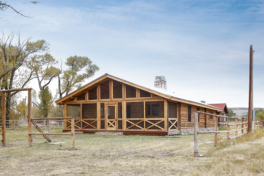 Timber frame cabin with screened porch