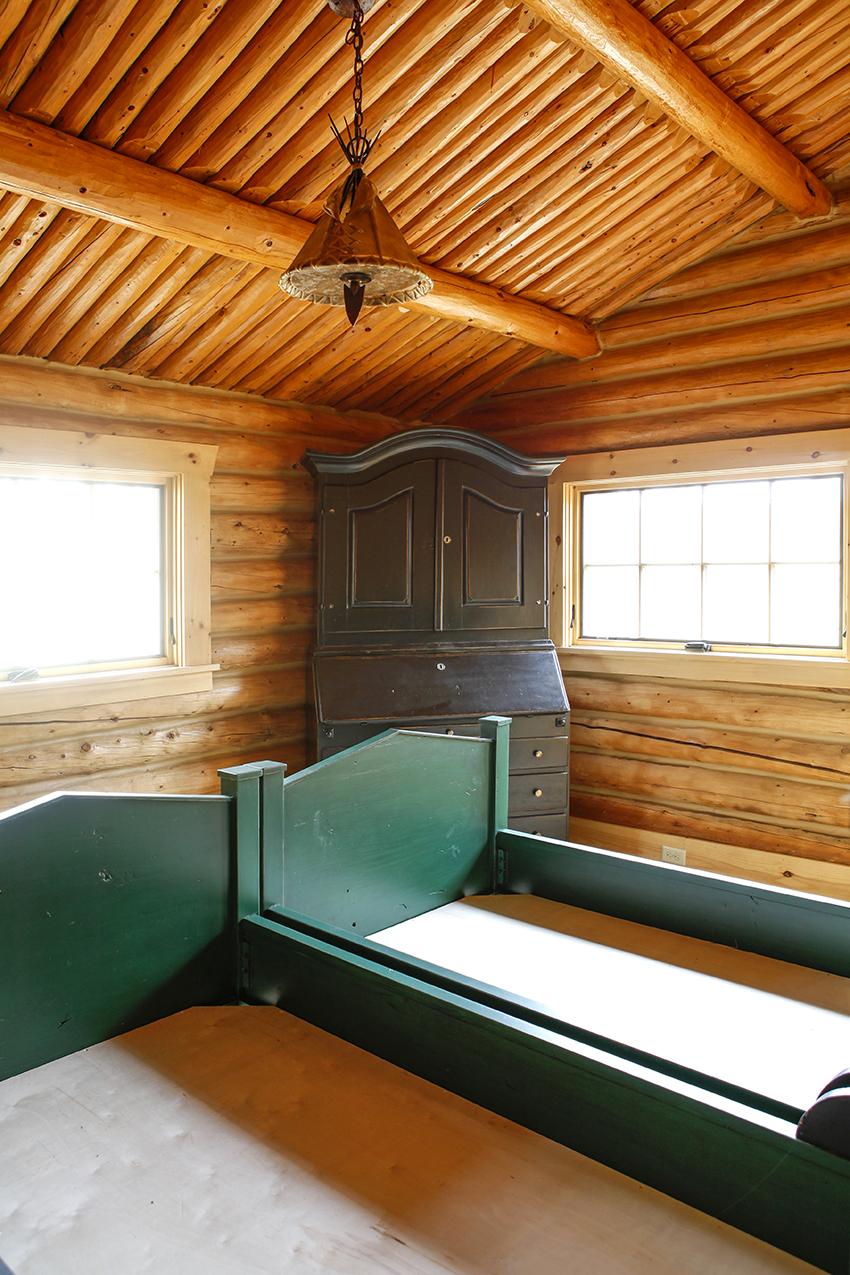 Bedroom with timber frame walls and ceiling