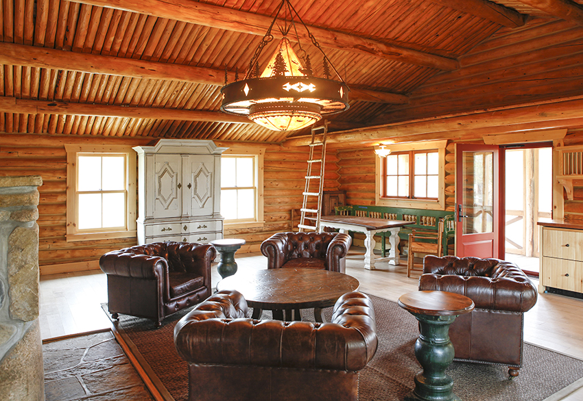 Cabin area great room with chandelier and furniture