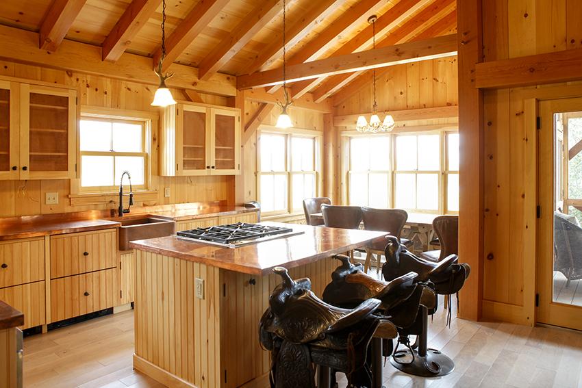 Cabin kitchen with horse saddle stools