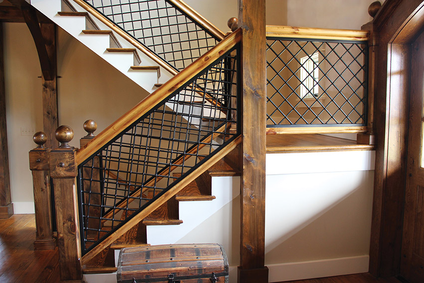 Handcrafted wood and iron design railing