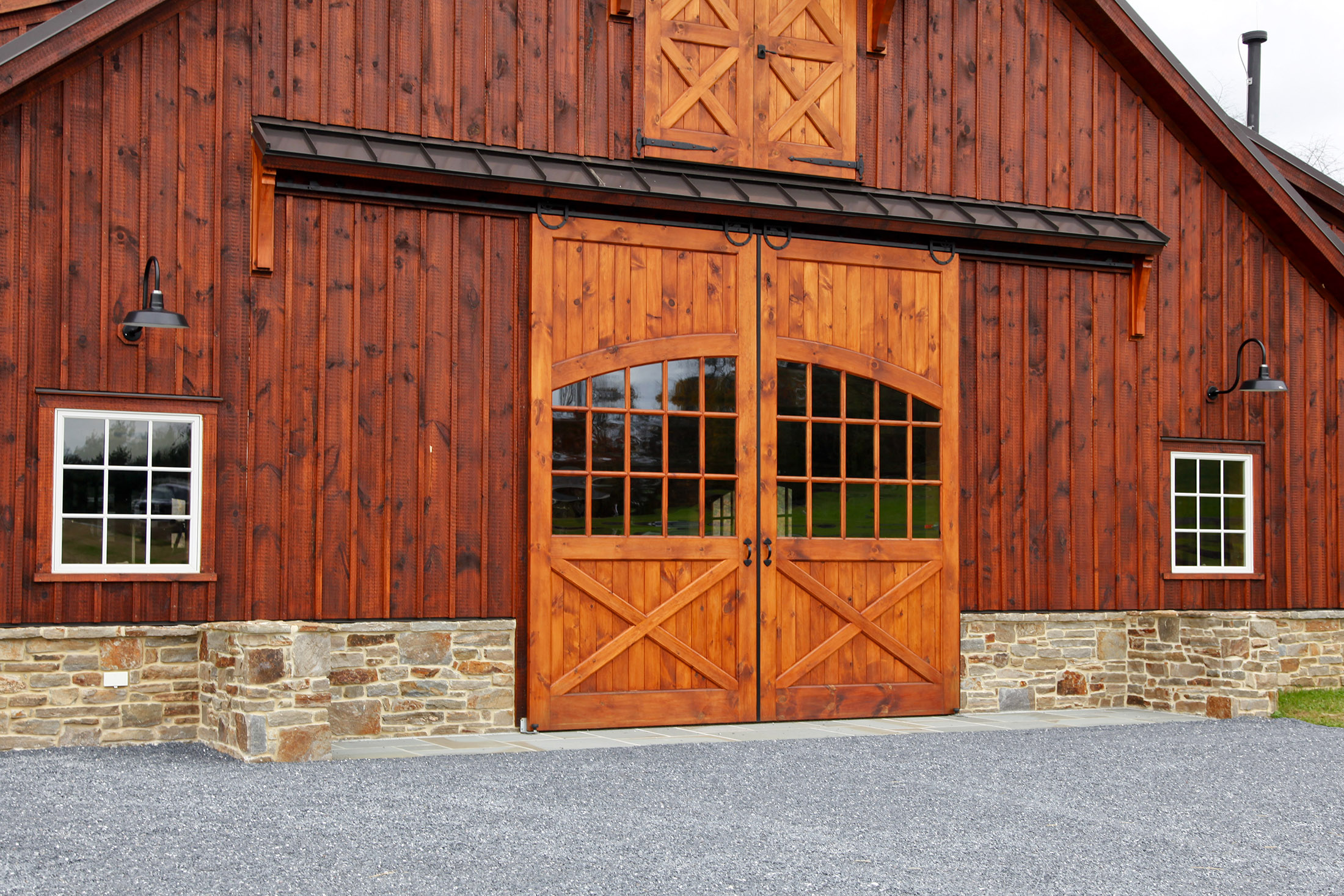 Sliding wooden barn doors with double window