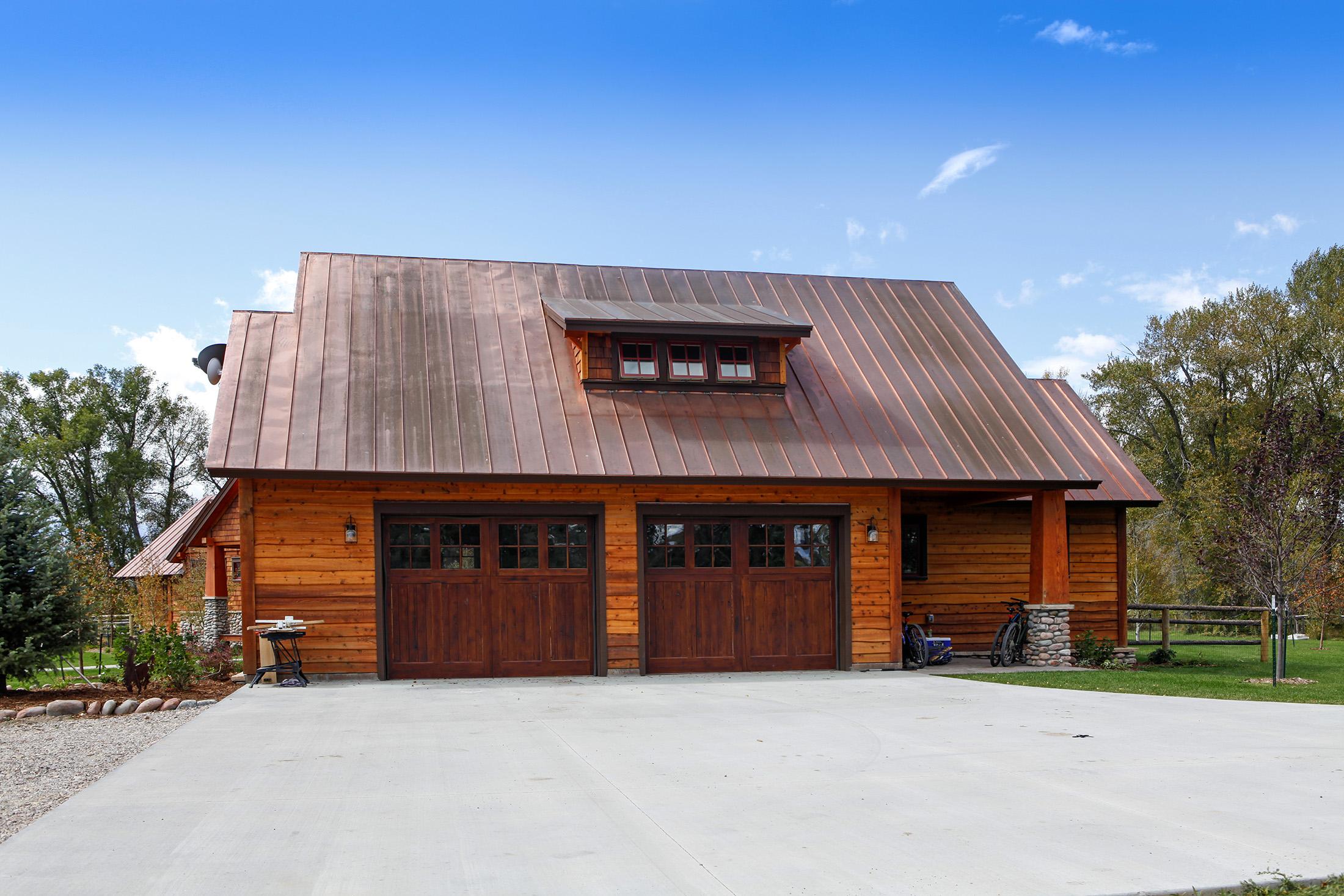Custom wooden garage with overhead door and windows