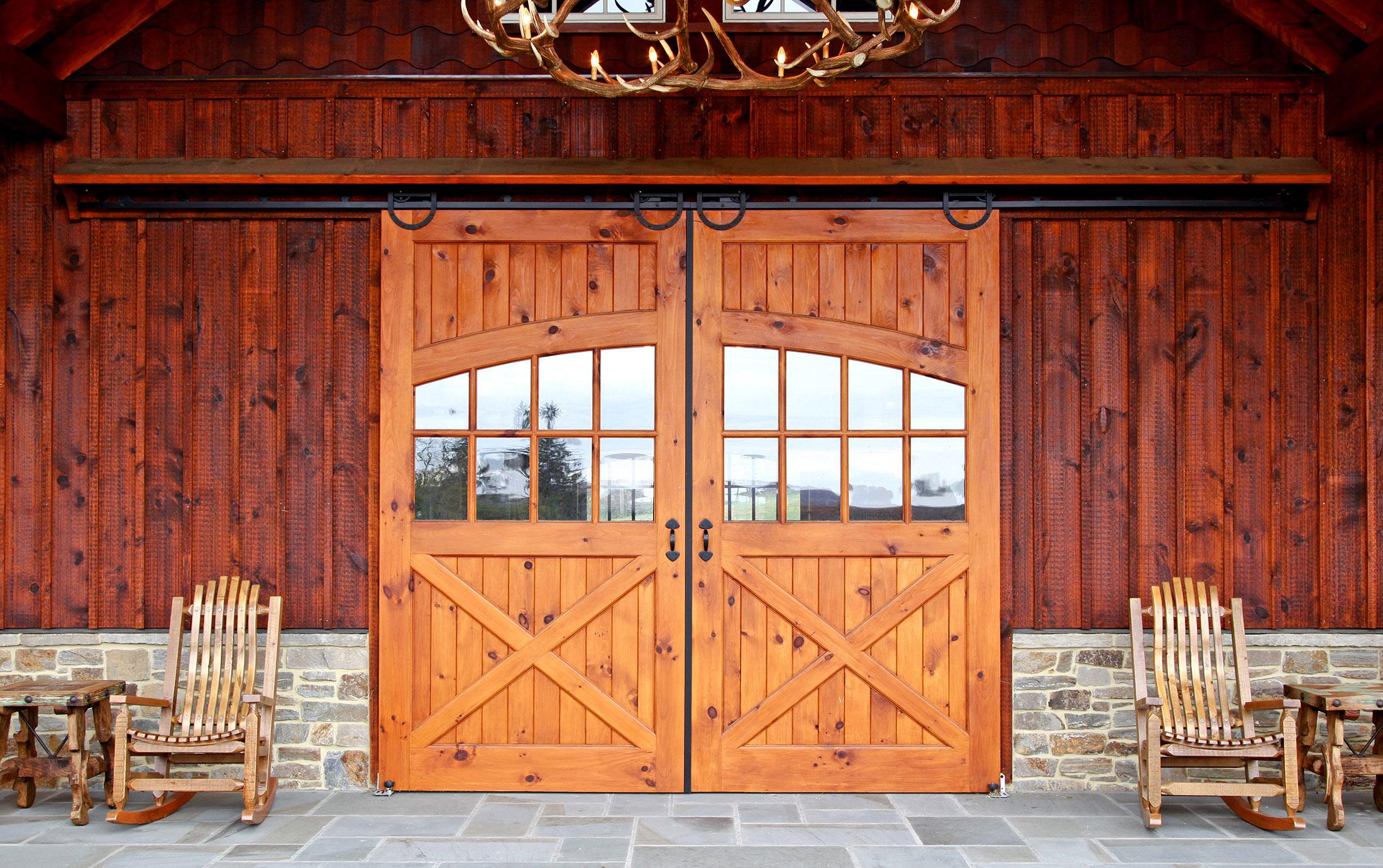Barn entrance showing a solid door sliding barn doors with window