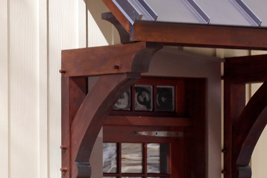 Detail of a timber frame mortise and tenon custom entranceway