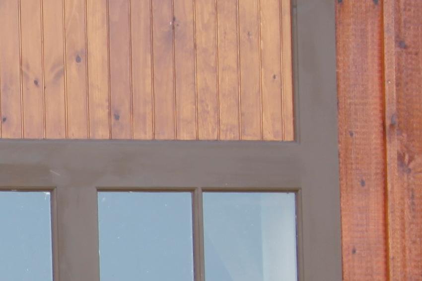 Detail of rail and mullion of a split slider door in white pine