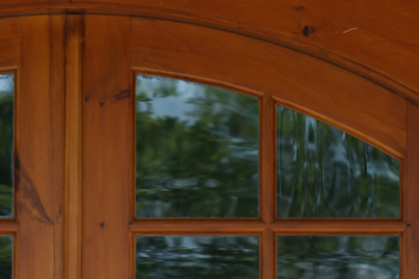 Window detail of a barn entrance with a puritan pine finish