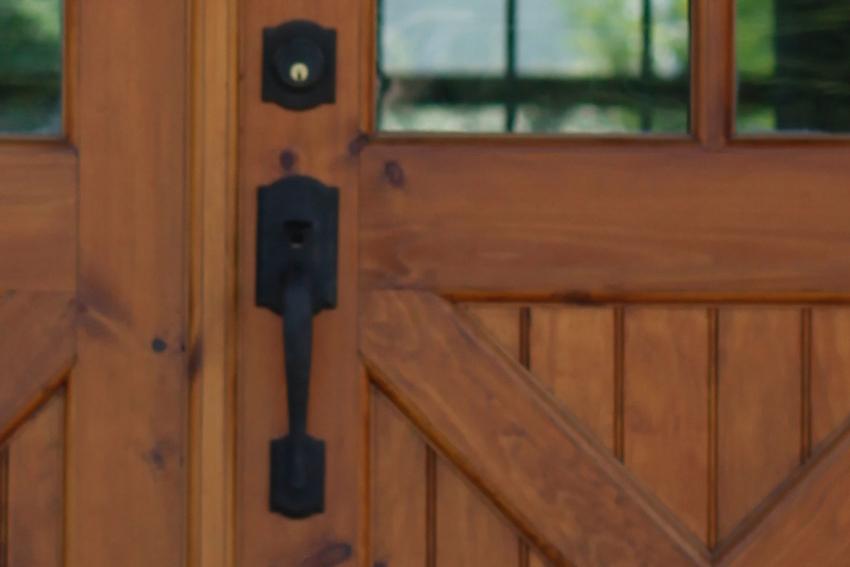 Detail of a Delaney model door pull on a Puritan Pine finish door