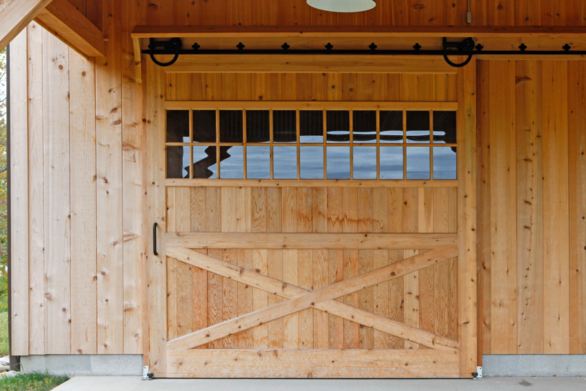 Single slide door on a barn made from unfinished wood