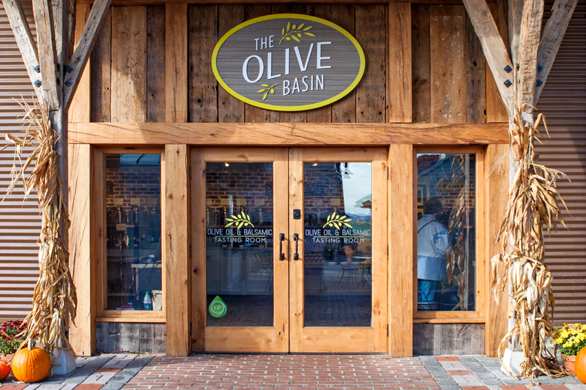 Glass front door to the Olive Basin store in Intercourse, PA
