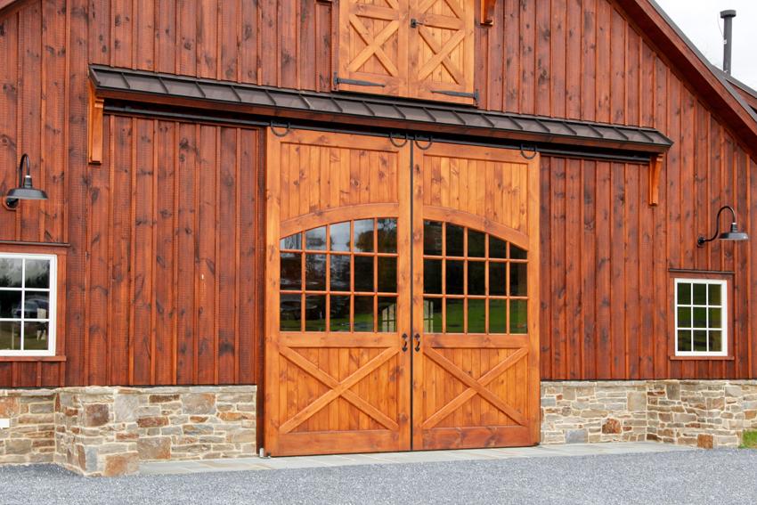 Rear slider doors on a wooden barn