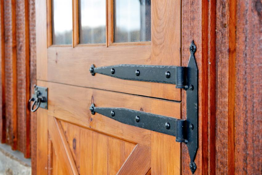 Detail of strap hinges on custom Dutch door