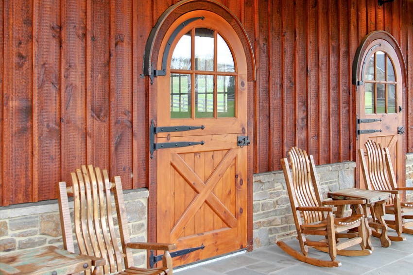 Side view of two custom arched wooden doors