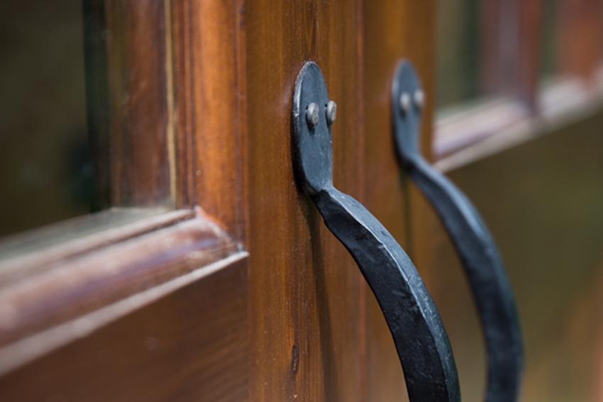Barn door detail with custom hardware pulls