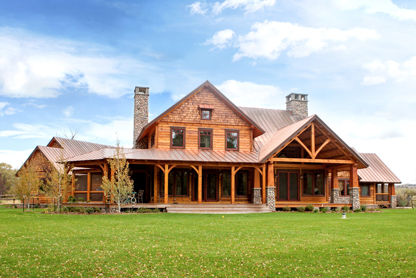 A timber frame home in WY with a back porch